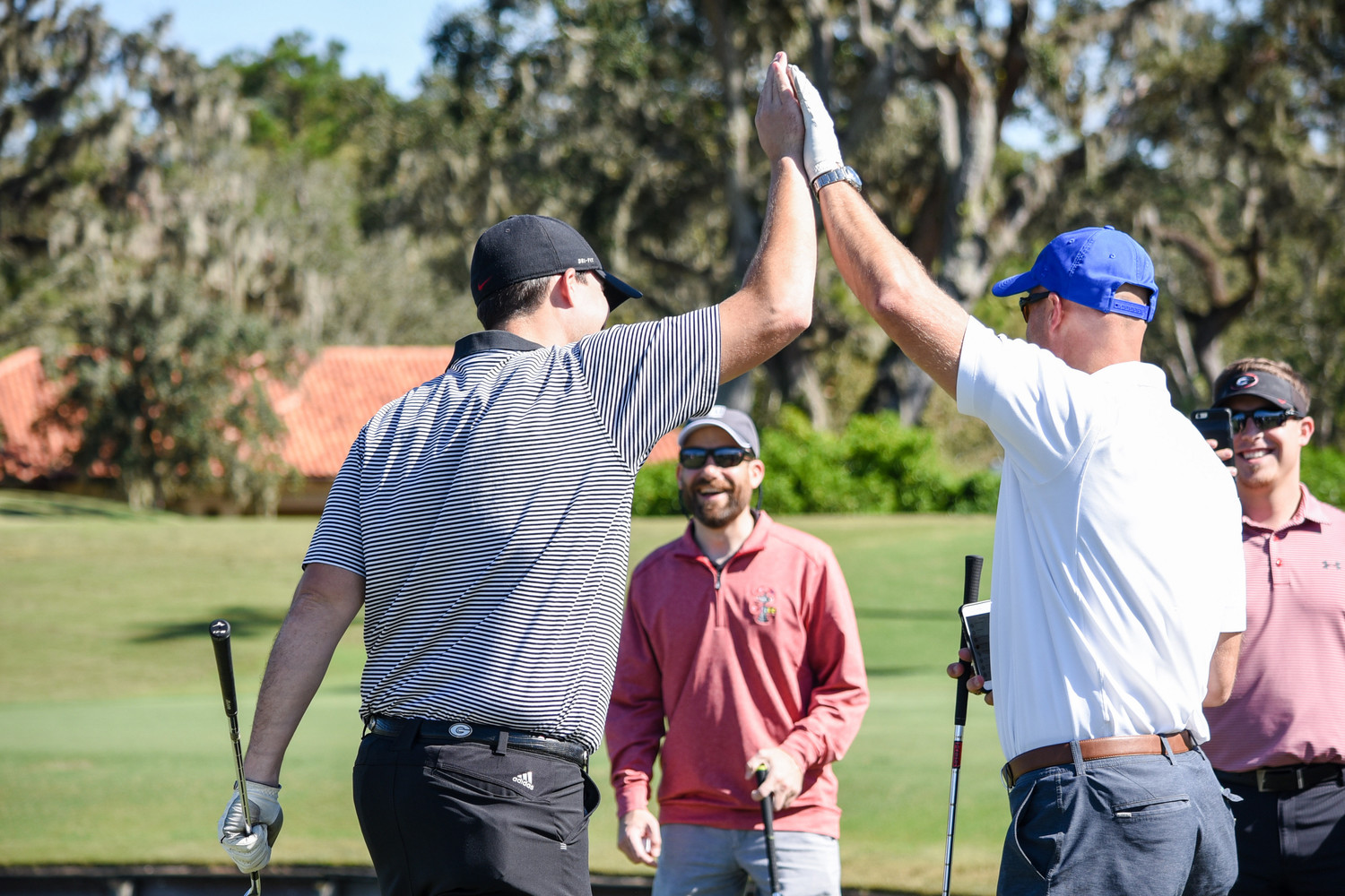 Danny Wuerffel (right) celebrates his team's success during the Desire Cup.