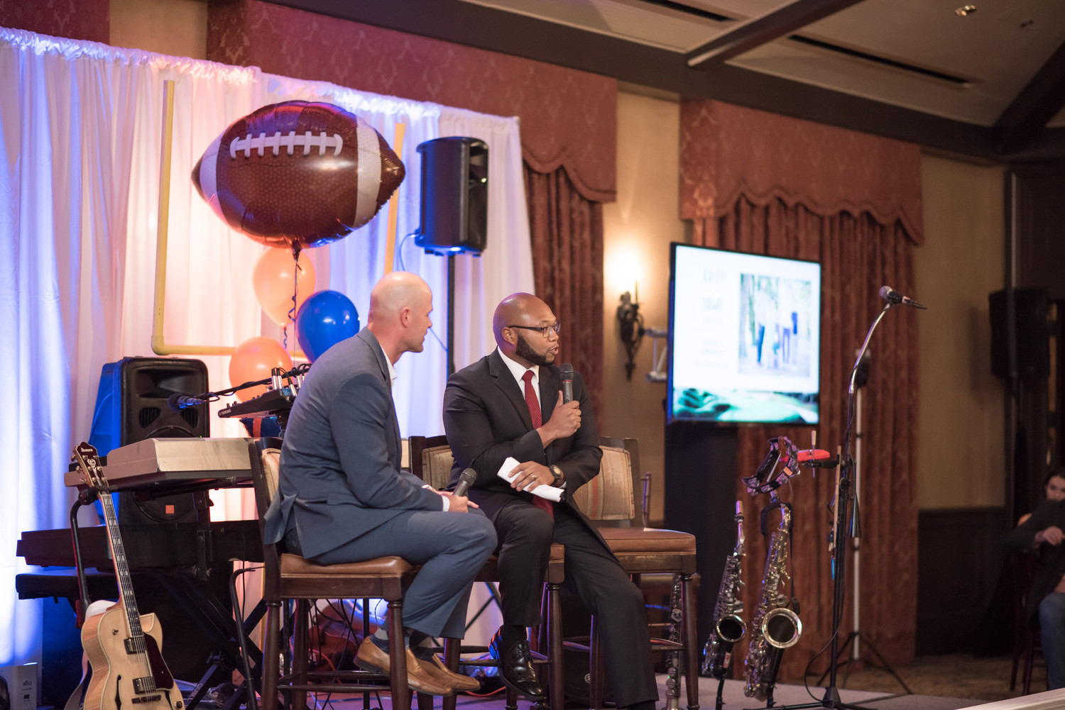 Danny Wuerffel interviews Demetrius Summerville, executive director of Kaley Square in Orlando (Desire Street Ministry partner), during the dinner Thursday evening.