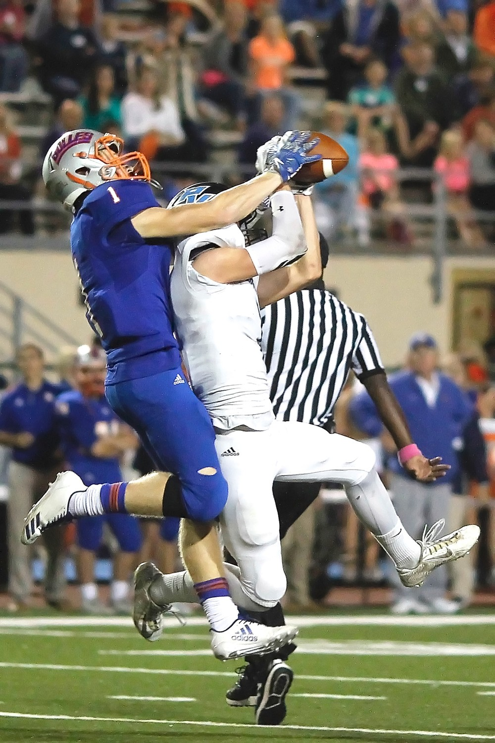 Jarrett Stepp pulls in the ball in front of the Bolles defender.