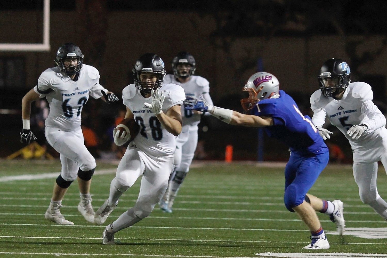 Collin Magill runs for 10 yards against Bolles.