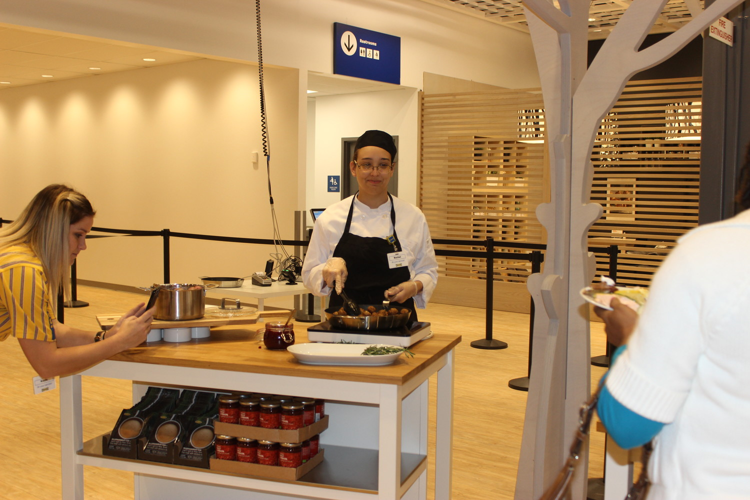 A restaurant employee serves IKEA's famous Swedish meatballs during a press preview breakfast last week.