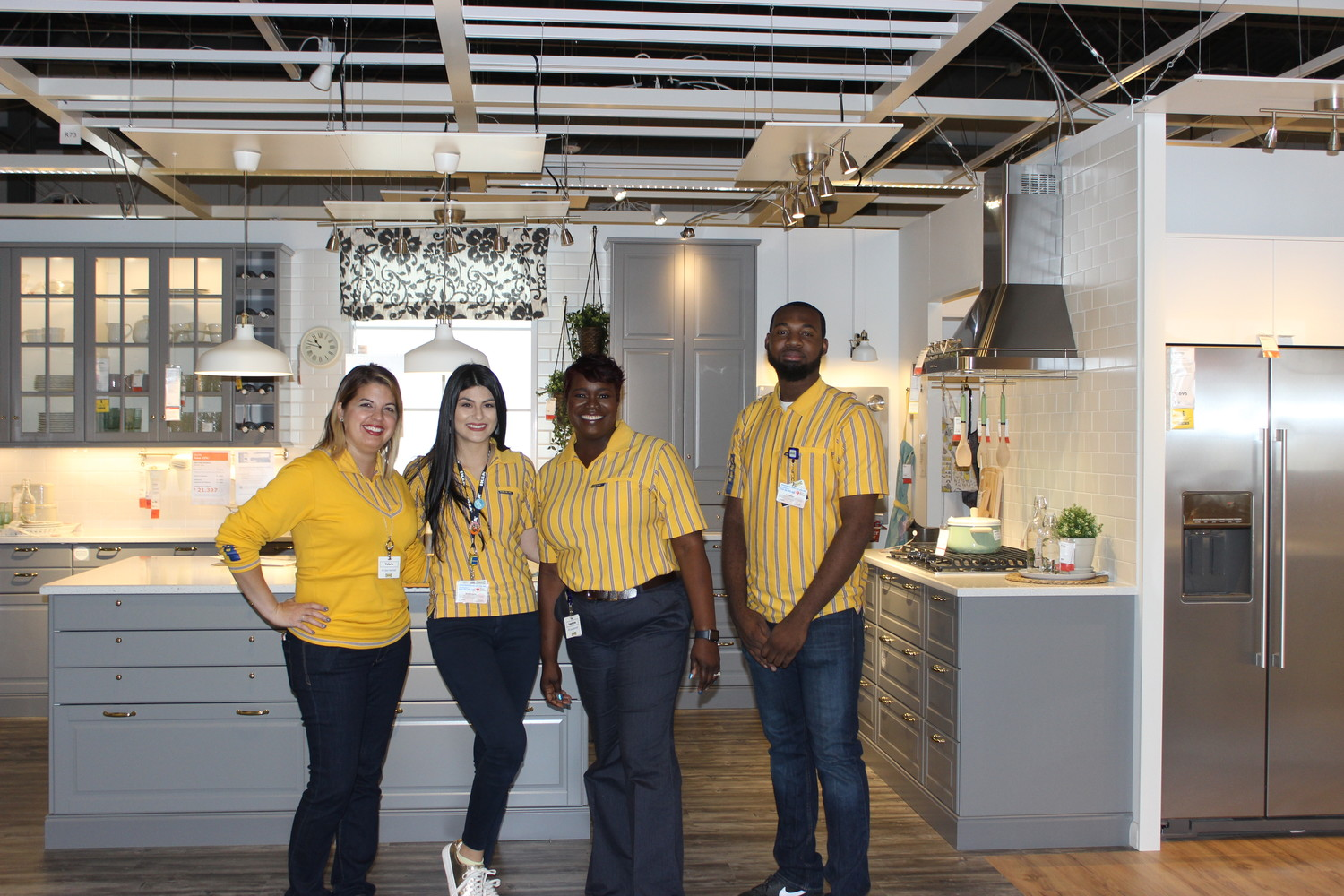 IKEA employees Mandy Michelle (from left), Val Martinez, store manager Leontyne Sykes and kitchen sales manager Eric Madison stand in front of a kitchen design display at the new Jacksonville store.