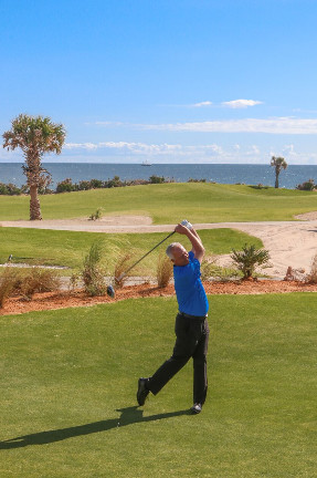 Hammock Beach Director of Golf Brad Hauer hits a ceremonial first tee shot at the re-opening of the Ocean Course at Hammock Beach Resort Nov. 2.