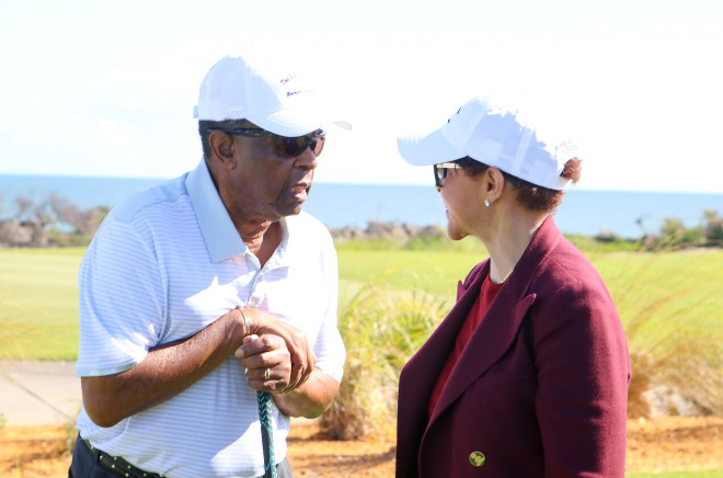 Lee Elder, four-time winner on the PGA TOUR and the first African American to play in The Masters, talks with Sheila Johnson, founder and CEO of Salamander Hotels & Resorts, at the re-opening of the Ocean Course at Hammock Beach Resort
