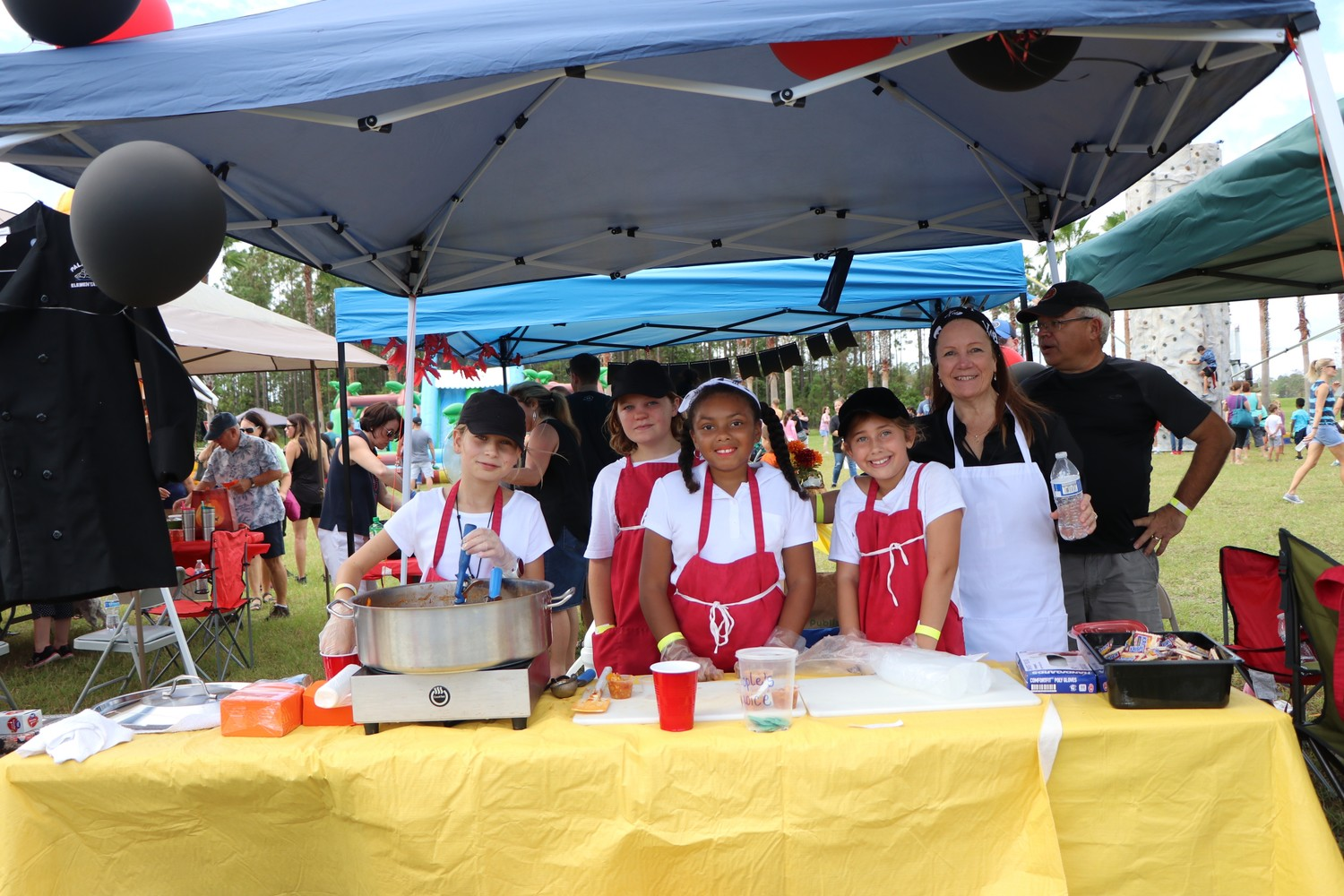 A team of local kids participates in the chili cook-off.