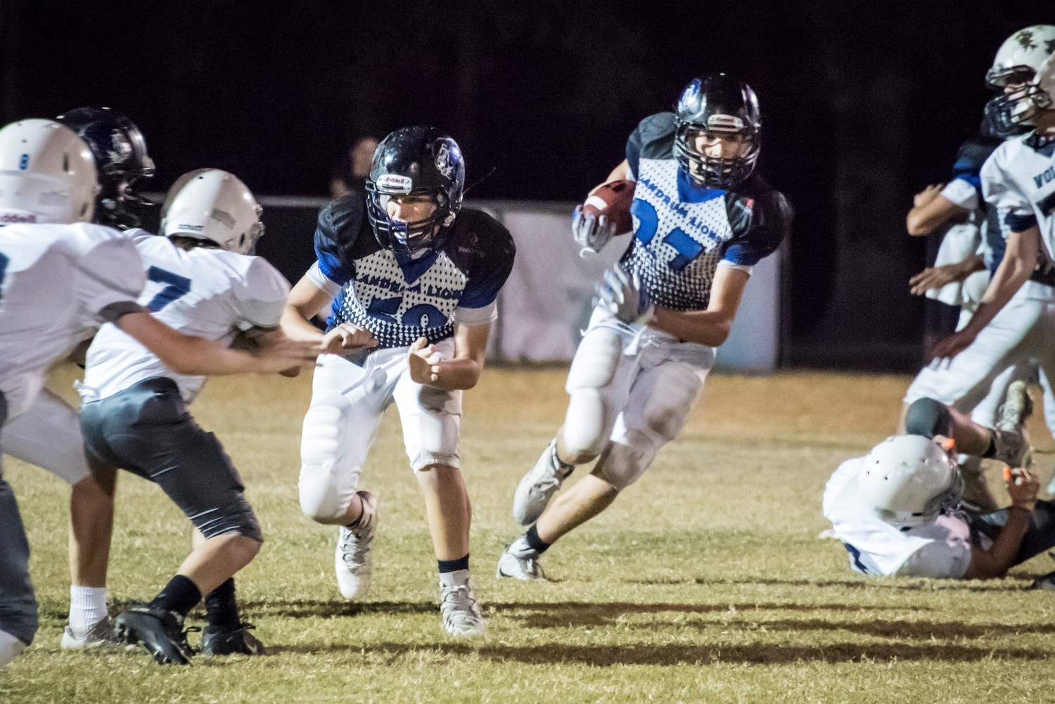 A Landrum ball carrier weaves his way through Wolves defenders.