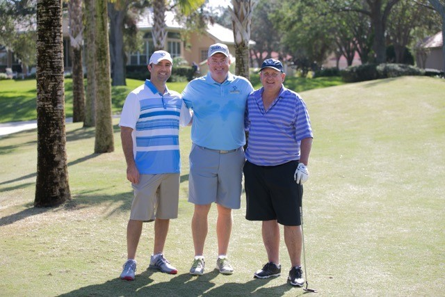 Charles Valenciana, Capt. Sean Haley and Marty Ewing gather during play.