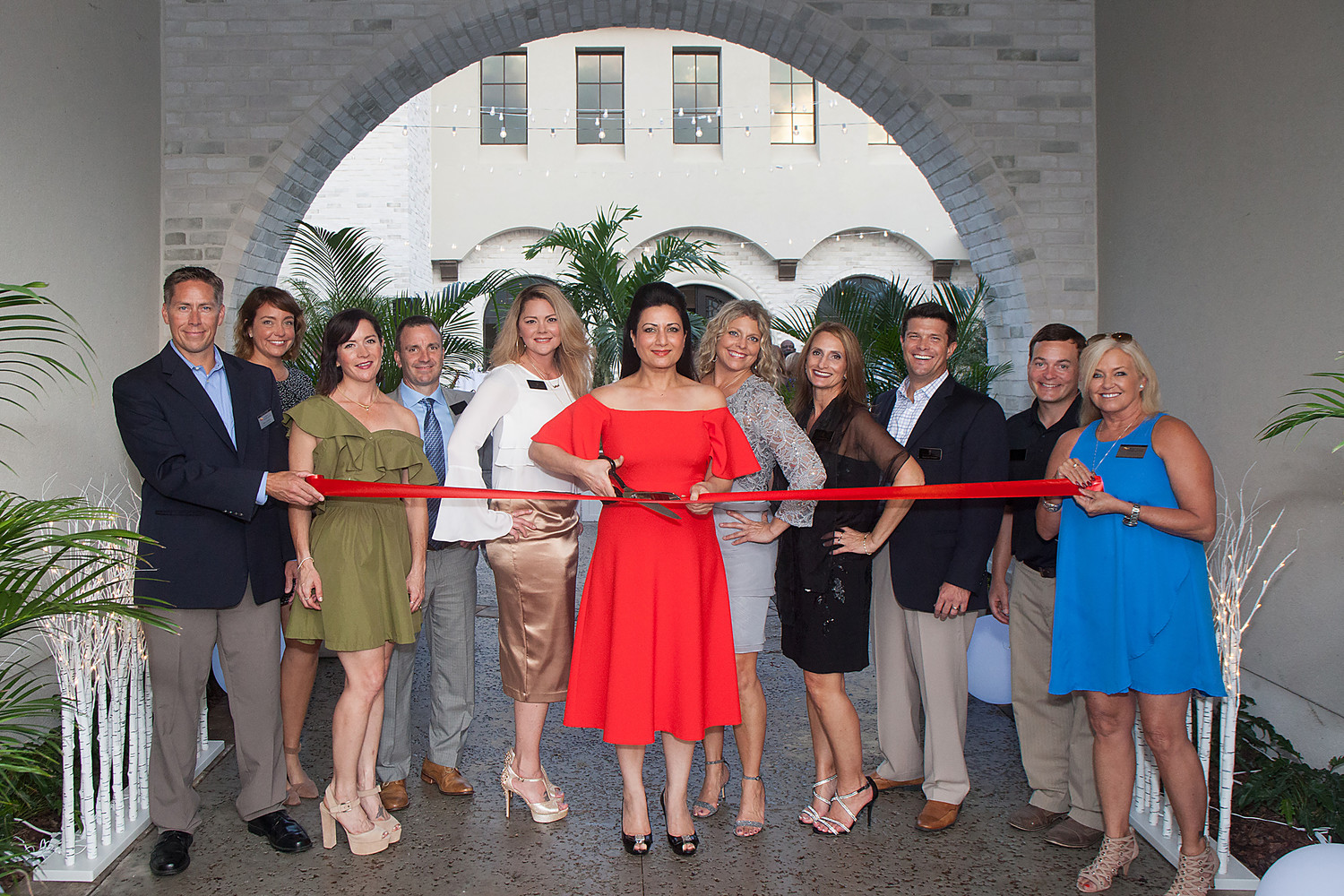 Representatives from The Pineapple Corporation and the St. Johns County Chamber of Commerce Ponte Vedra Beach Division celebrate the opening of the new model homes in the Vista at Twenty Mile with a ribbon cutting ceremony.