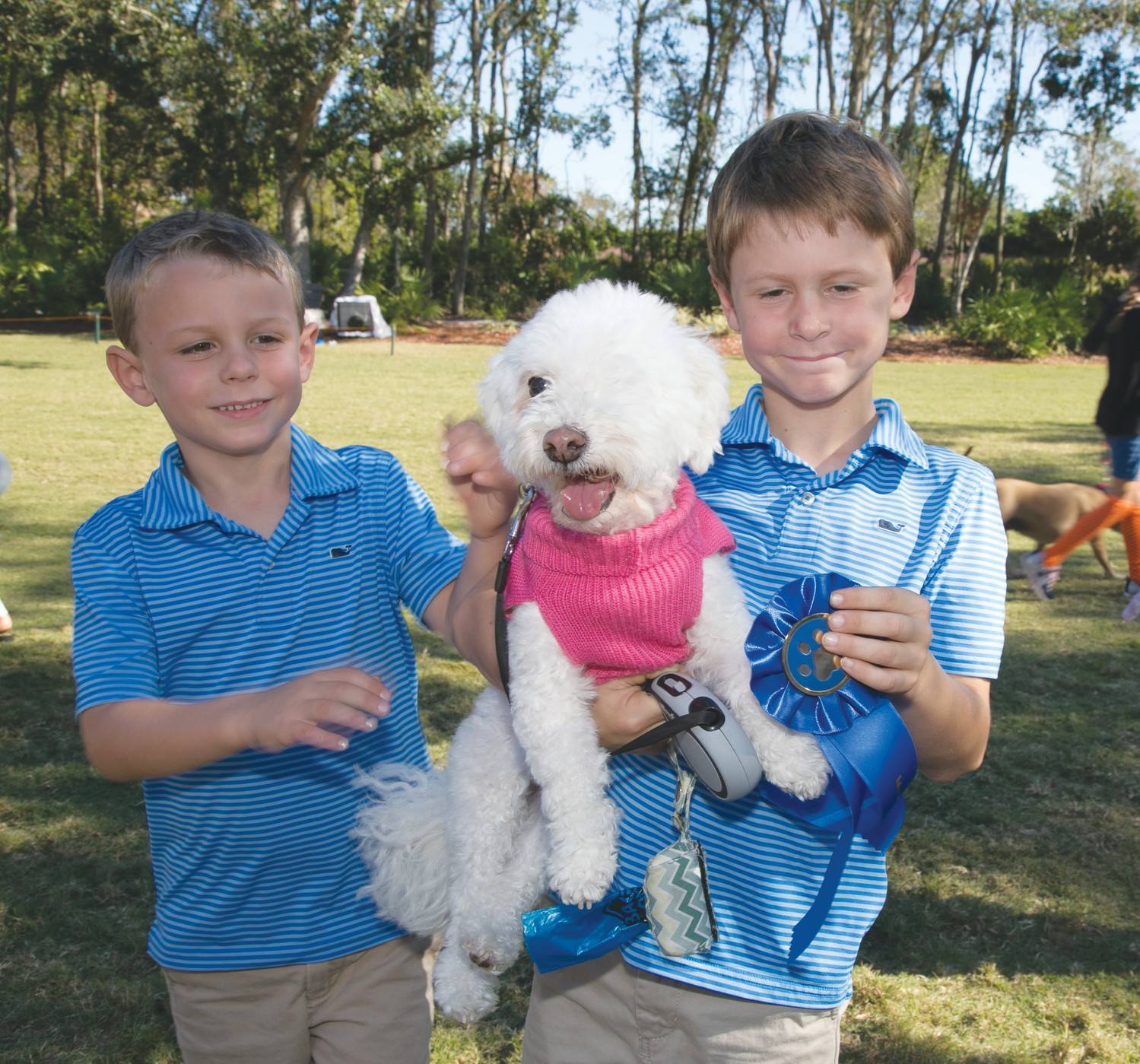 Knox, Memphis and Nash Cartwright enjoy Bark in the Park at the Plantation at Ponte Vedra Beach Nov. 4. The event benefited the Plantation Foundation, a scholarship fund for employees and dependents of employees. The day included a dog agility demonstration, a friendly dog show, a photo booth for pets, a mobile pet Groomer, a SAFE pet rescue van, music, refreshments and a raffle to benefit the Plantation Foundation.