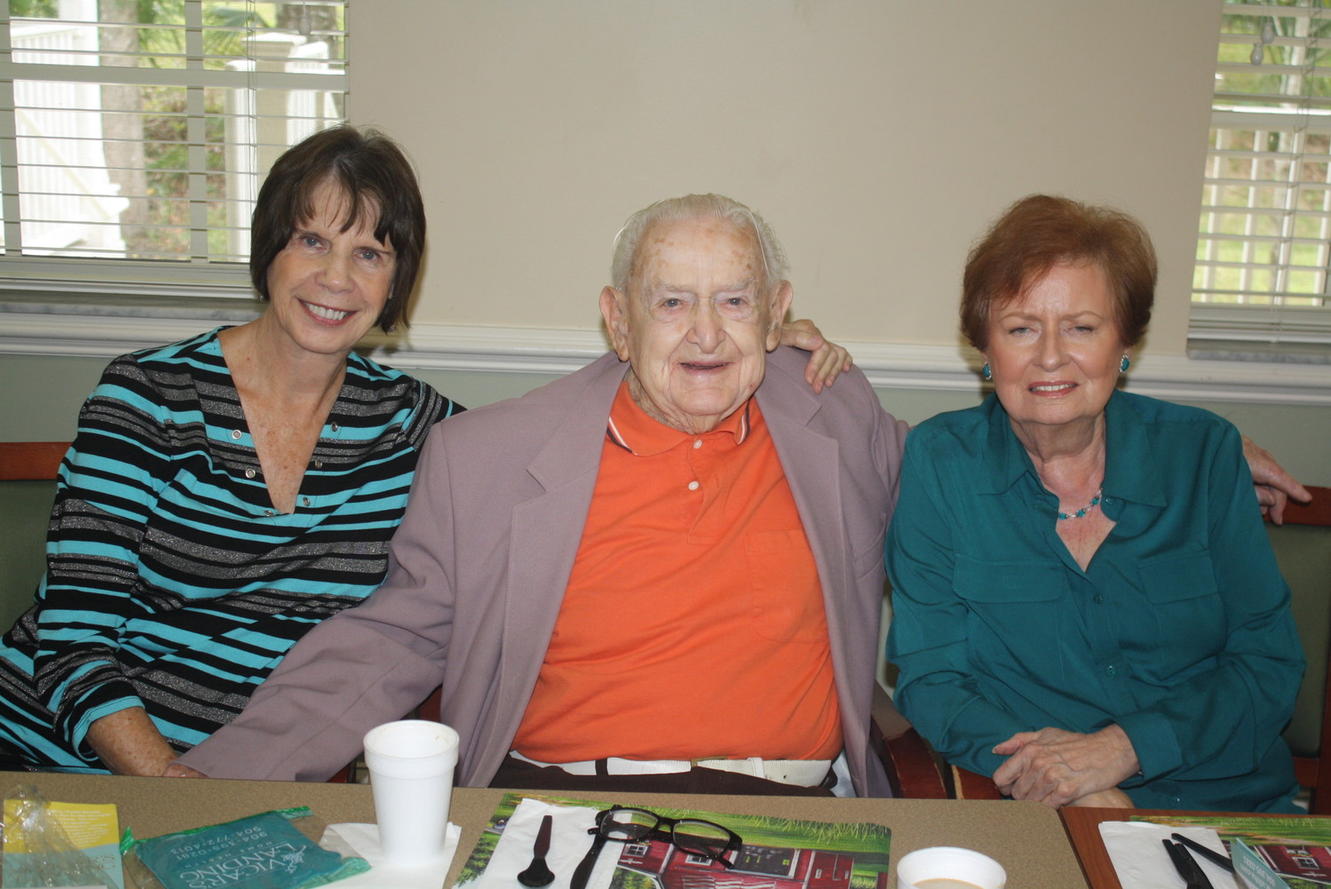 Joyce Scott, Nelson Johnson (97 years old, Army veteran in WWII) and Helen Martin