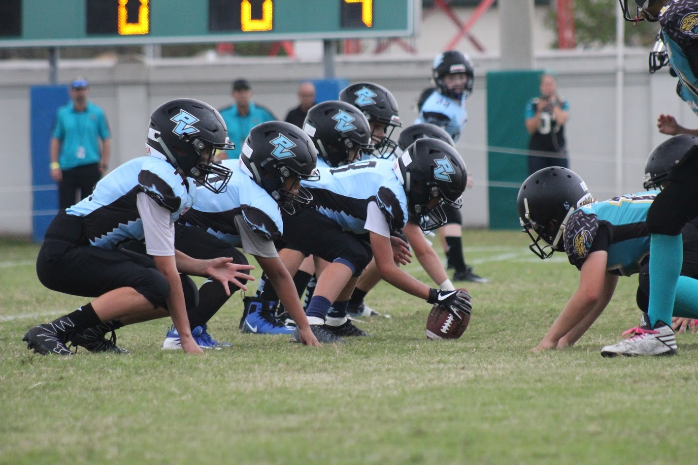 The Shark offensive line prepares to fire off the ball and engage the Jax Beach defense during the First Coast Conference Championship.