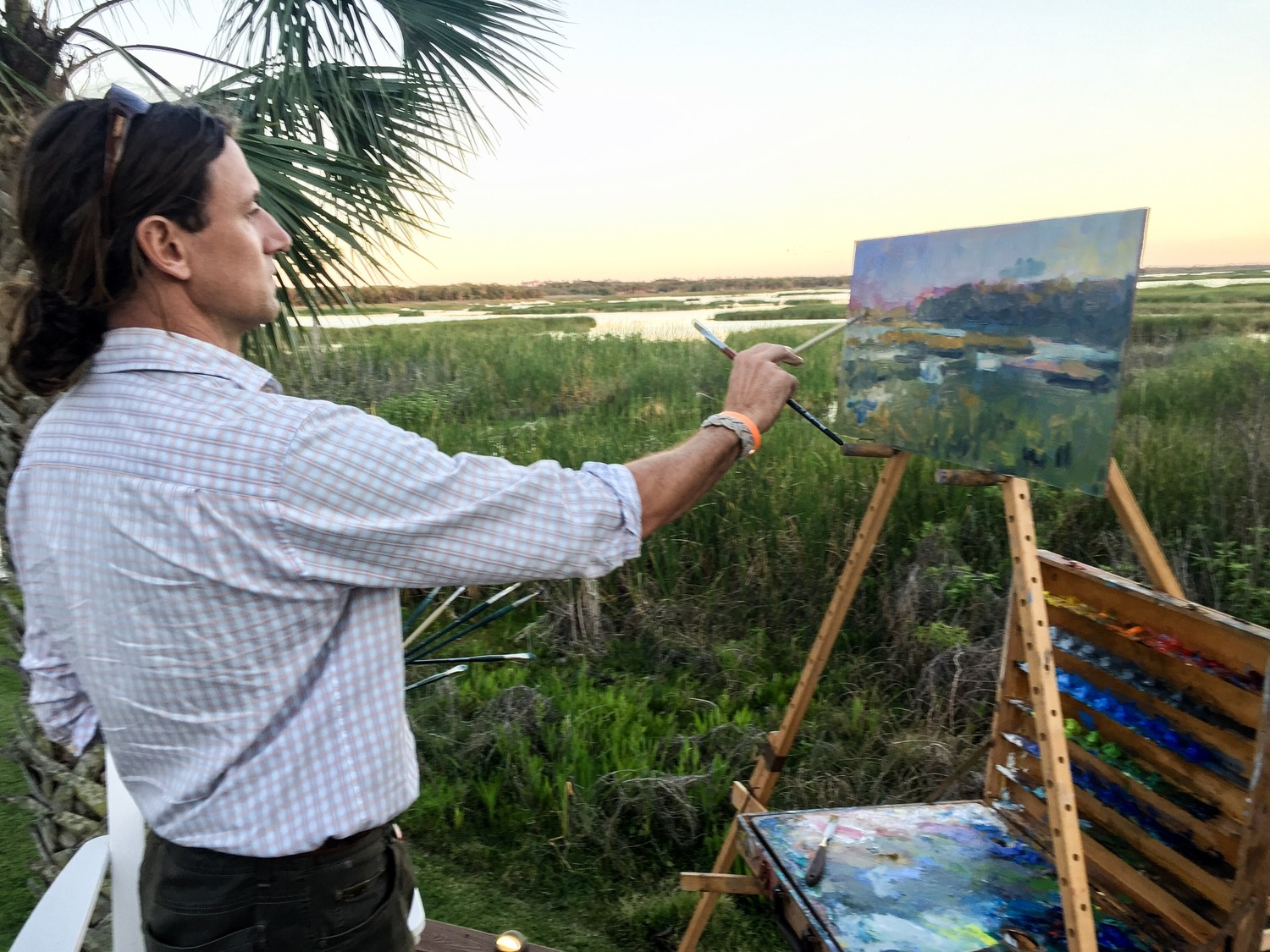 Eugene Quinn paints a scene at the Guana Preserve.