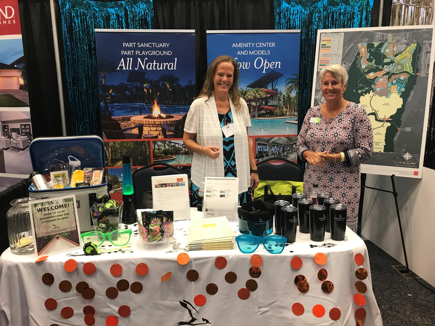 Representatives from Shearwater and Drees Homes, one of Shearwater's homebuilders, welcome visitors at the annual Realtor Builder Tradeshow.