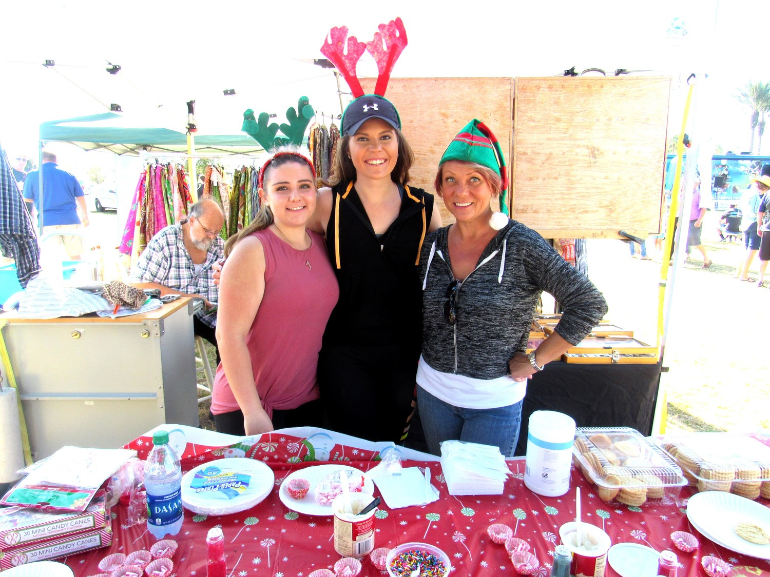 Destiny Drouillard, Lindsay Bryant and Leigh Norton man the Christmas cookie-decorating table at the Crosswater Community Church booth.