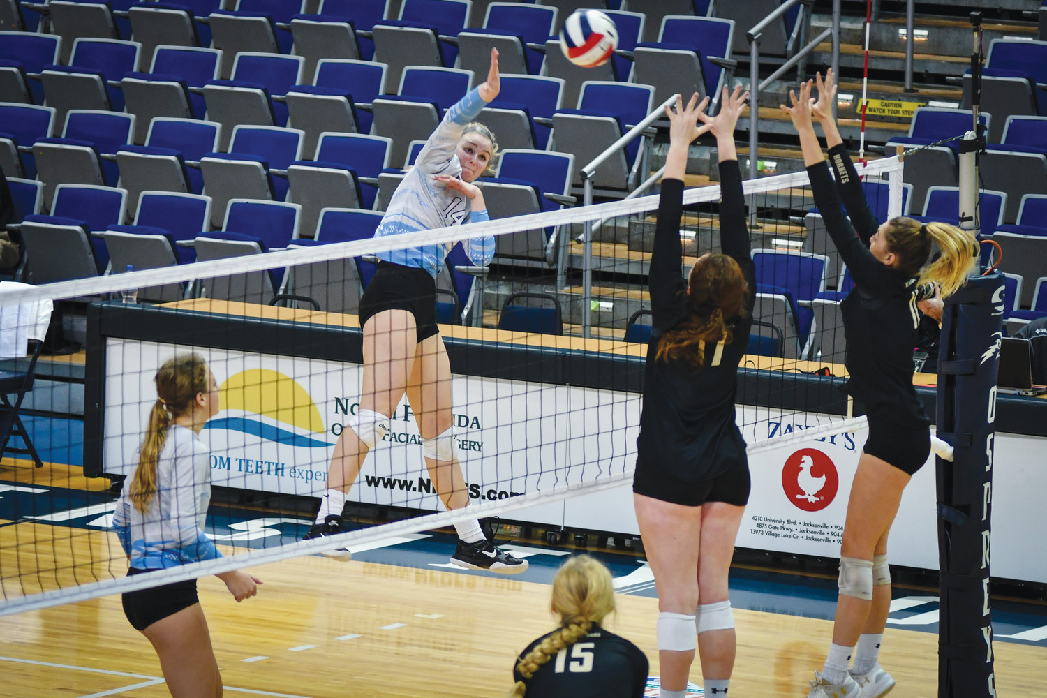 Paige Johnson, who finished the match with 12 kills, sends the ball over the net.