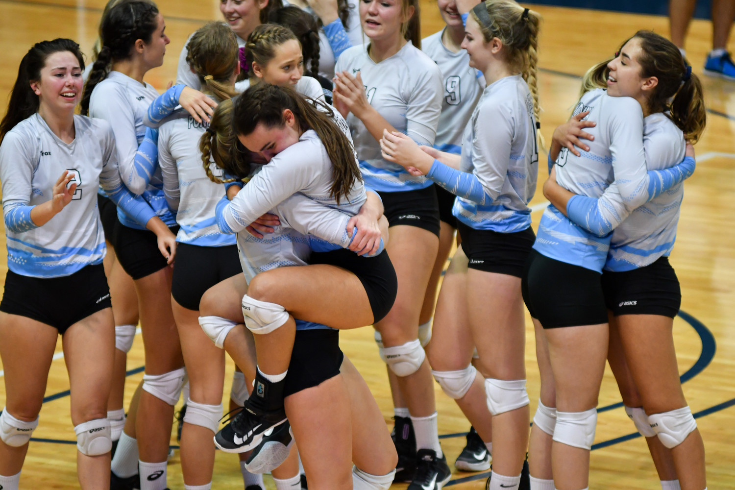 Ponte Vedra's girls volleyball team celebrates winning the Class 6A state title game against Bishop Moore Nov. 18.