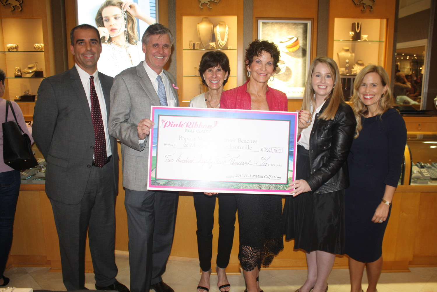Dr. Ryan Makar and Joe Mitrick of Baptist Medical Center Beaches, Pink Ribbon Golf Classic co-chairs Joanne Ghiloni and Nancy Morrison and Jackie Joy and Dr. Dawn Mussallem of Mayo Clinic-Jacksonville display the check total of $262,000, a record amount raised by the Ponte Vedra fundraiser.