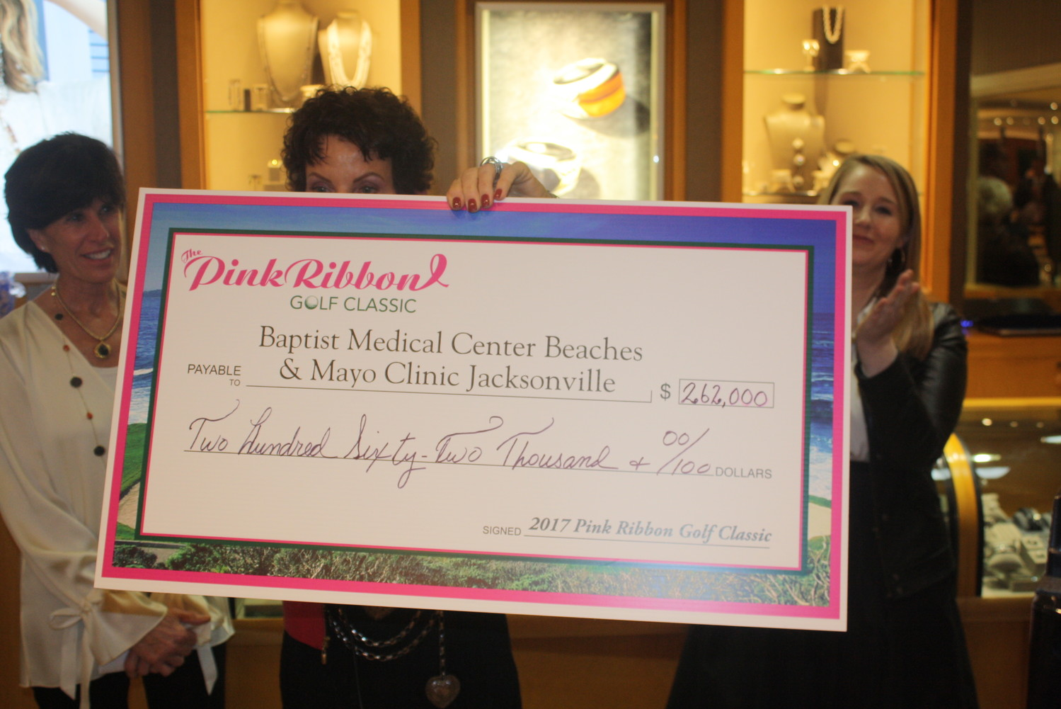 Pink Ribbon co-chair Nancy Morrison displays the check total of $262,000.