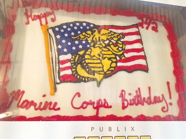Event attendees enjoy a cake celebrating the 242nd birthday of the U.S. Marine Corps.