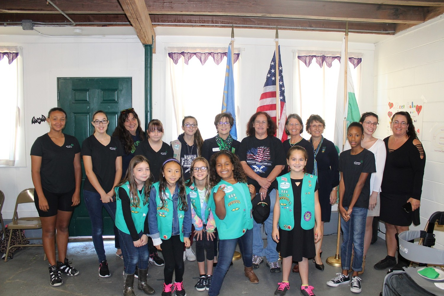 Girl Scouts, alumnae, supporters and Girl Scouts of Gateway Council CEO Mary Anne Jacobs gather at the Beaches Little House closing ceremony.