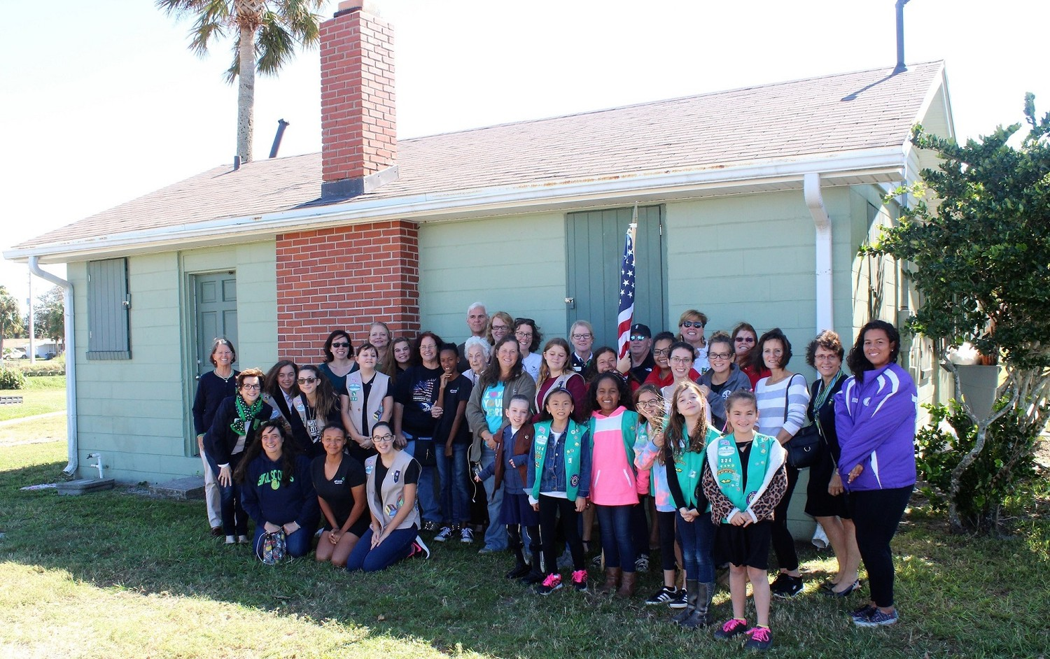 Three generations of Girl Scouts join Girl Scouts of Gateway Council CEO Mary Anne Jacobs outside of the Beaches Little House in Neptune Beach.