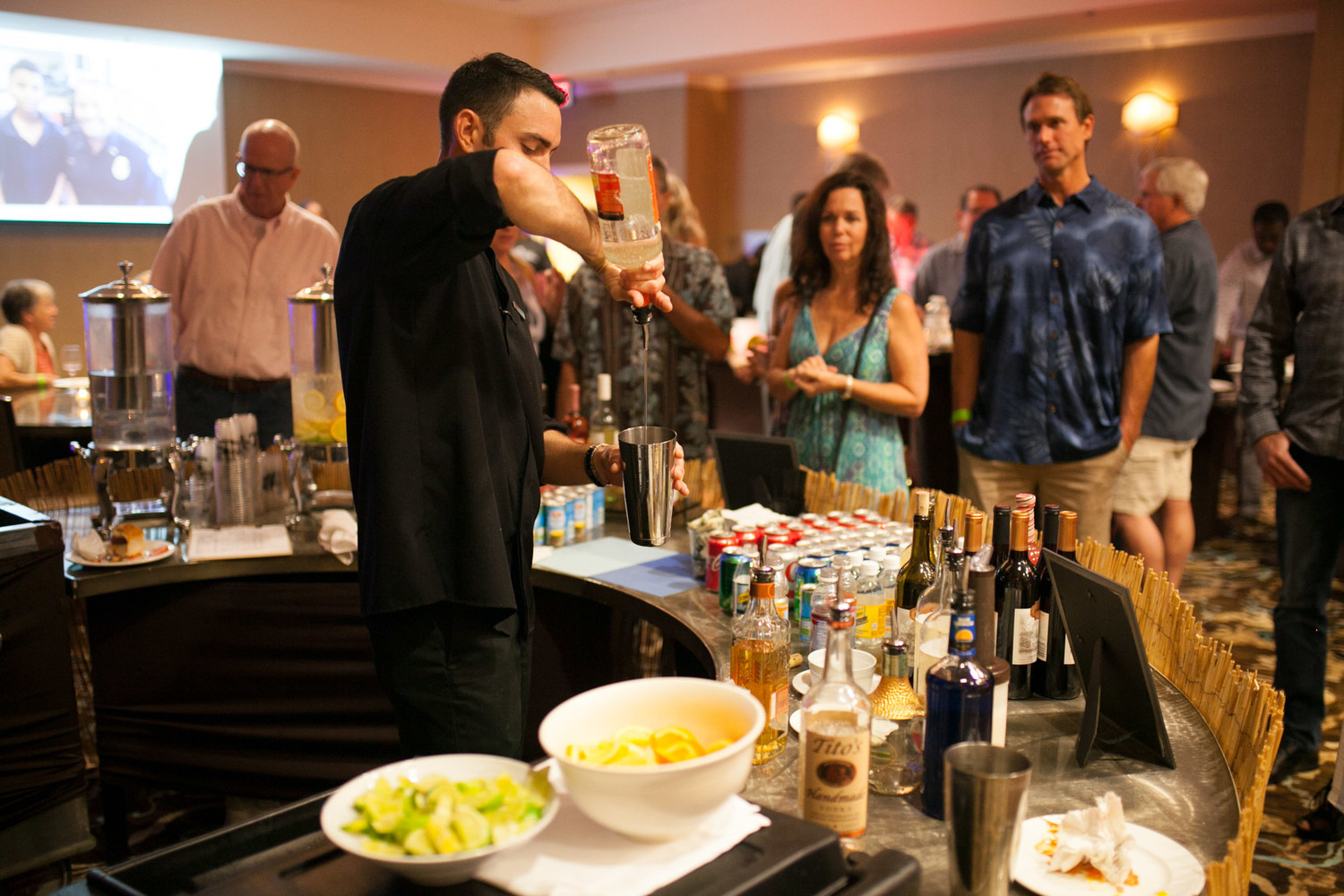A bartender serves up one of the event's signature drinks.