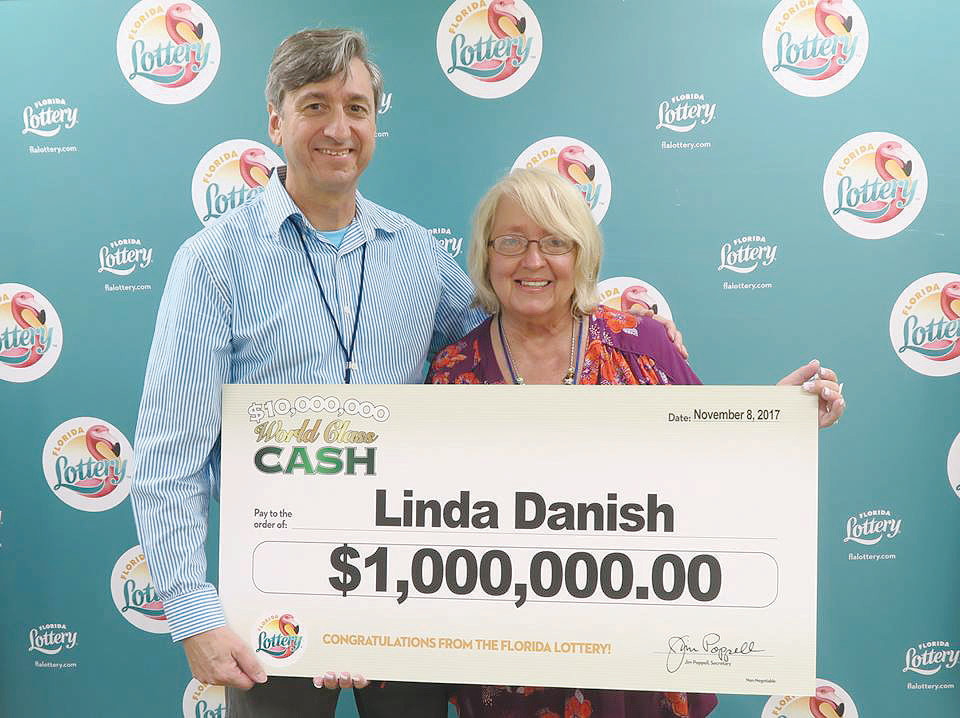 Linda Danish (right) claims her winnings at the Florida Lottery headquarters in Tallahassee on Nov. 9.