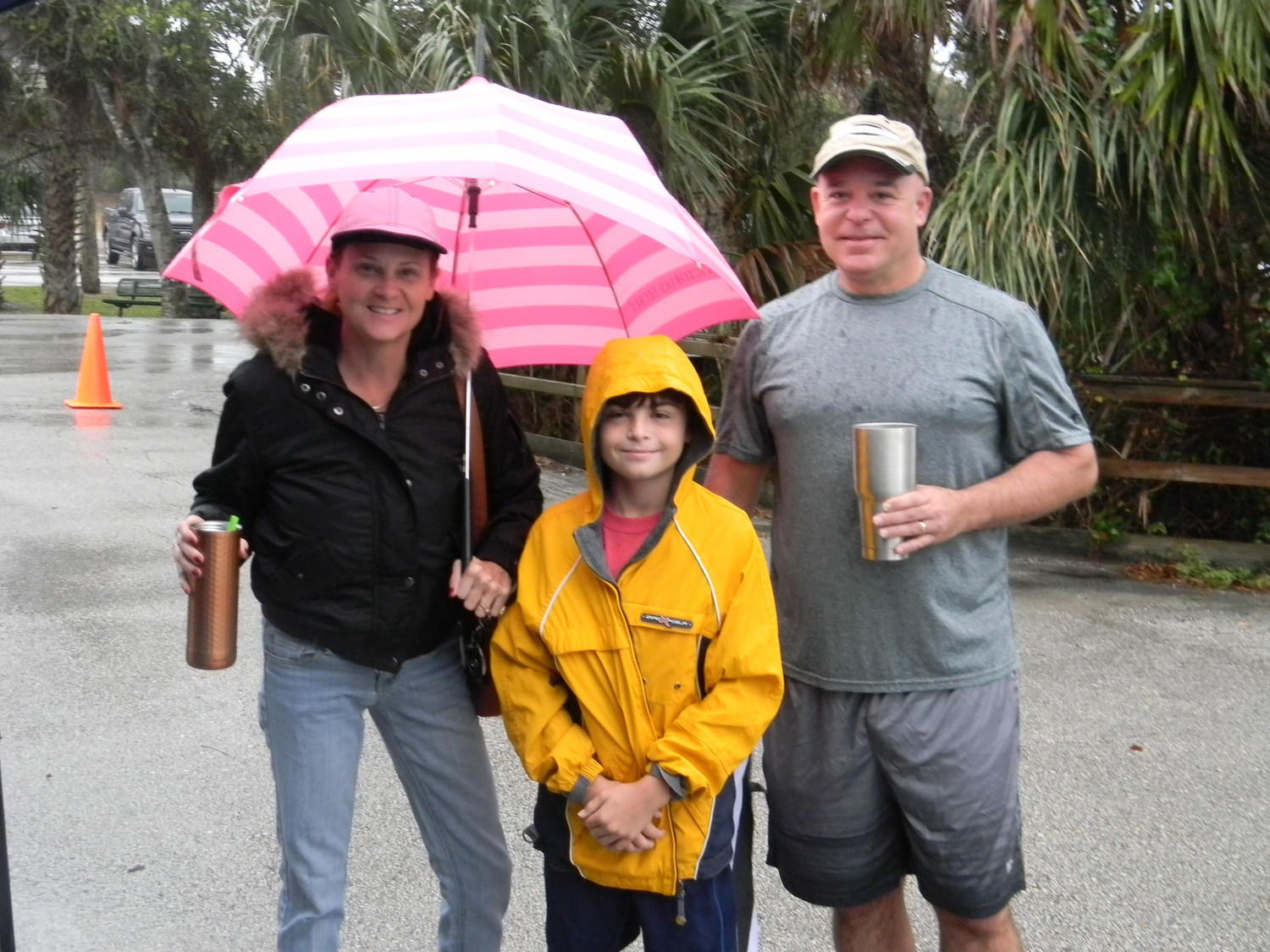 Ponte Vedra YMCA cross country participant Joseph Lane (middle) with his parents Victoria and Timothy Lane