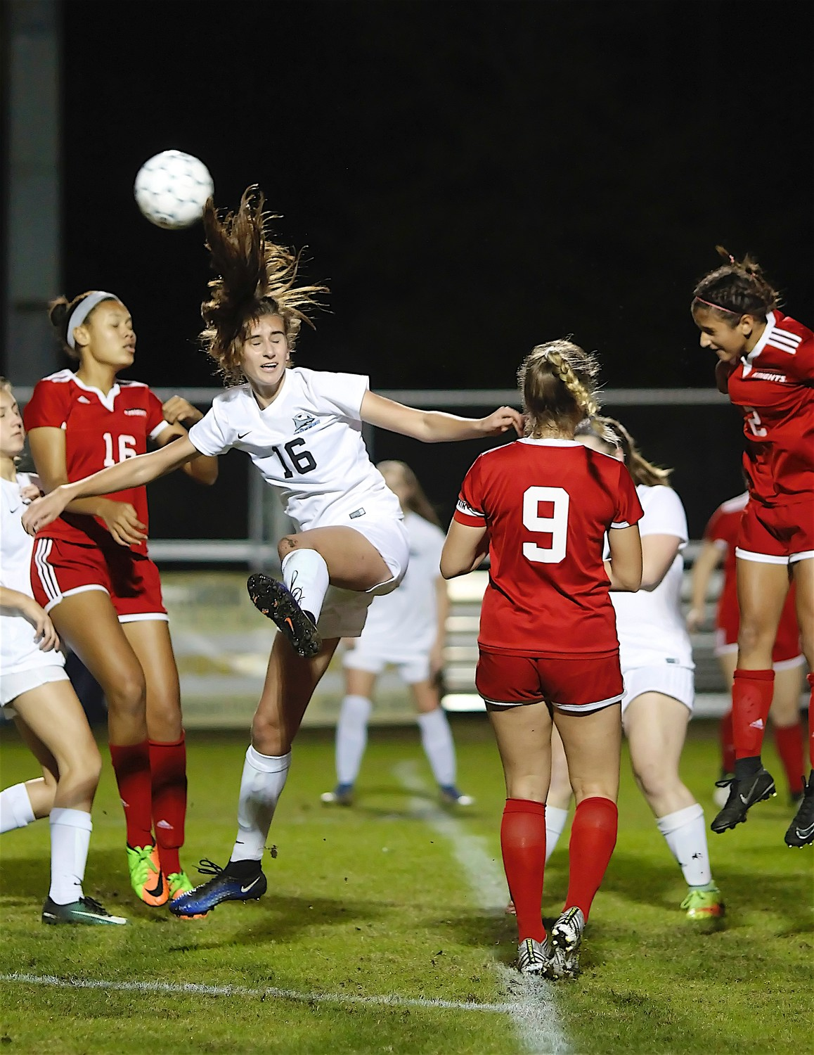 Julia Deal's hair flies as she heads the ball for the Sharks.