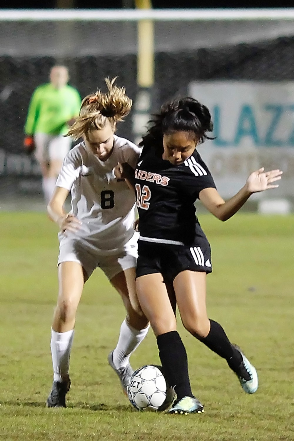 Cassidy Bierwagen fights for control of the ball for the Sharks.
