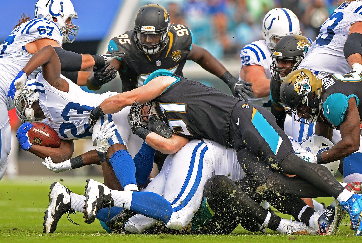 Jaguars Linebacker Paul Posluszny wraps up Colts running back Frank Gore in Jacksonville's 30-10 rout of Indianapolis.