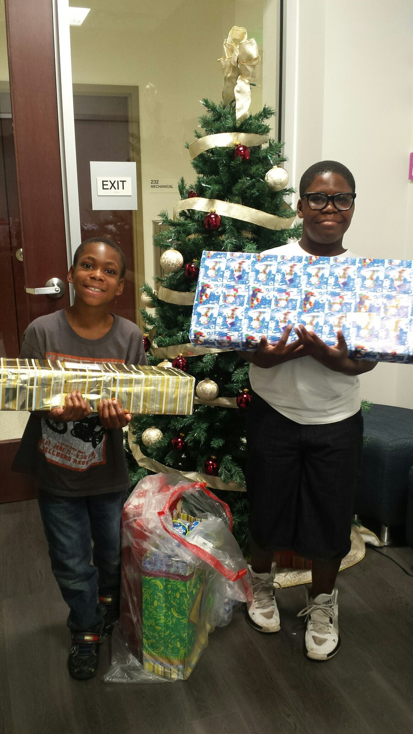 Big Brothers Big Sisters of Northeast Florida students receive gifts provided by community supporters.