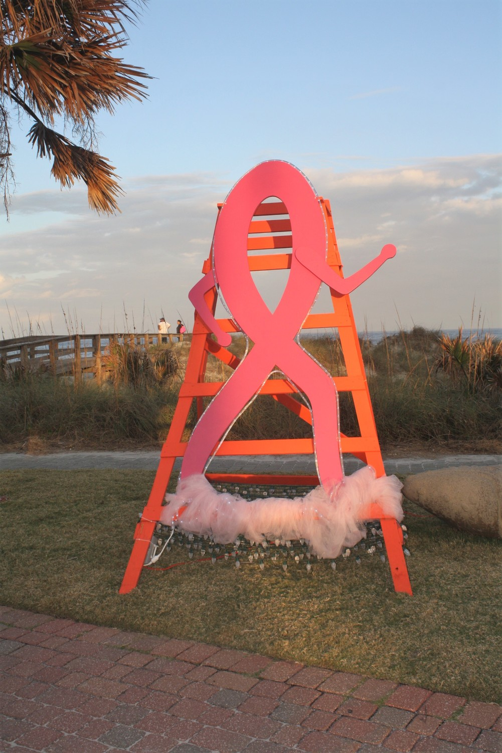 "The DONNA Foundation's ""Deck the Chairs"" Community Chair stands next to the organization's newly-installed commemorative bricks in Oceanfront Park."
