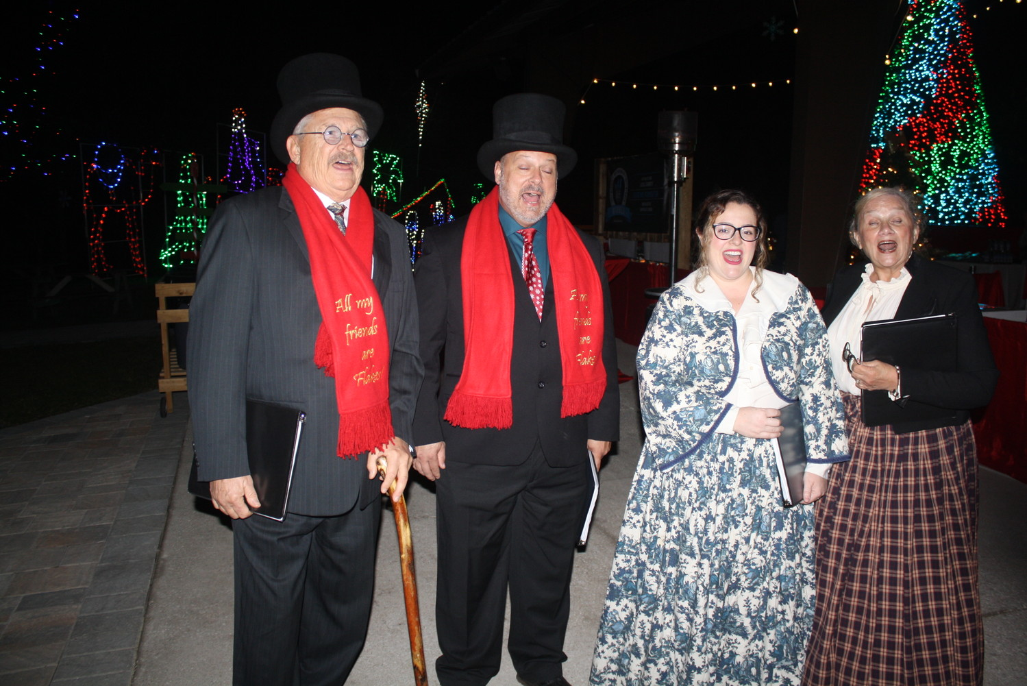 Carolers stroll through the Village.