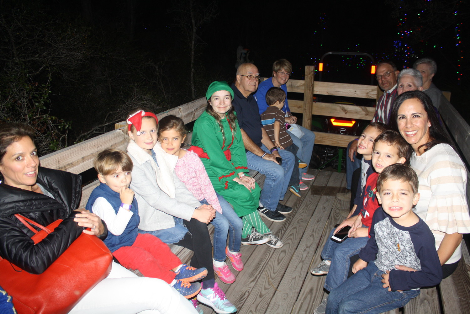 Visitors enjoy a tractor ride on the Enchanted Trail.