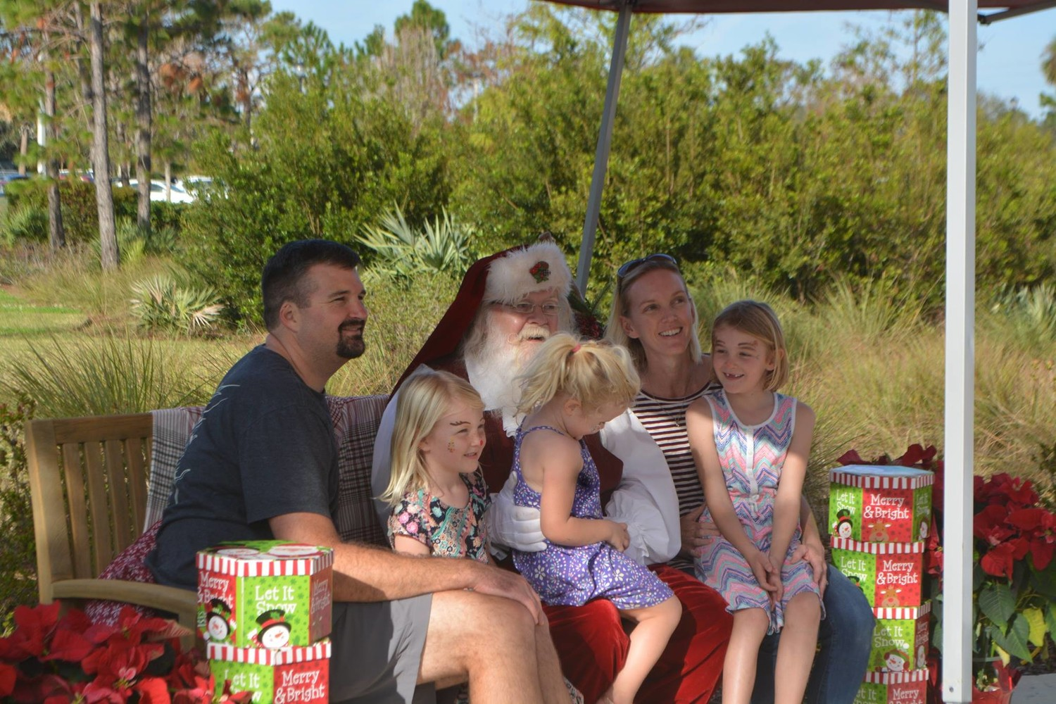 A family poses for pictures with Santa.