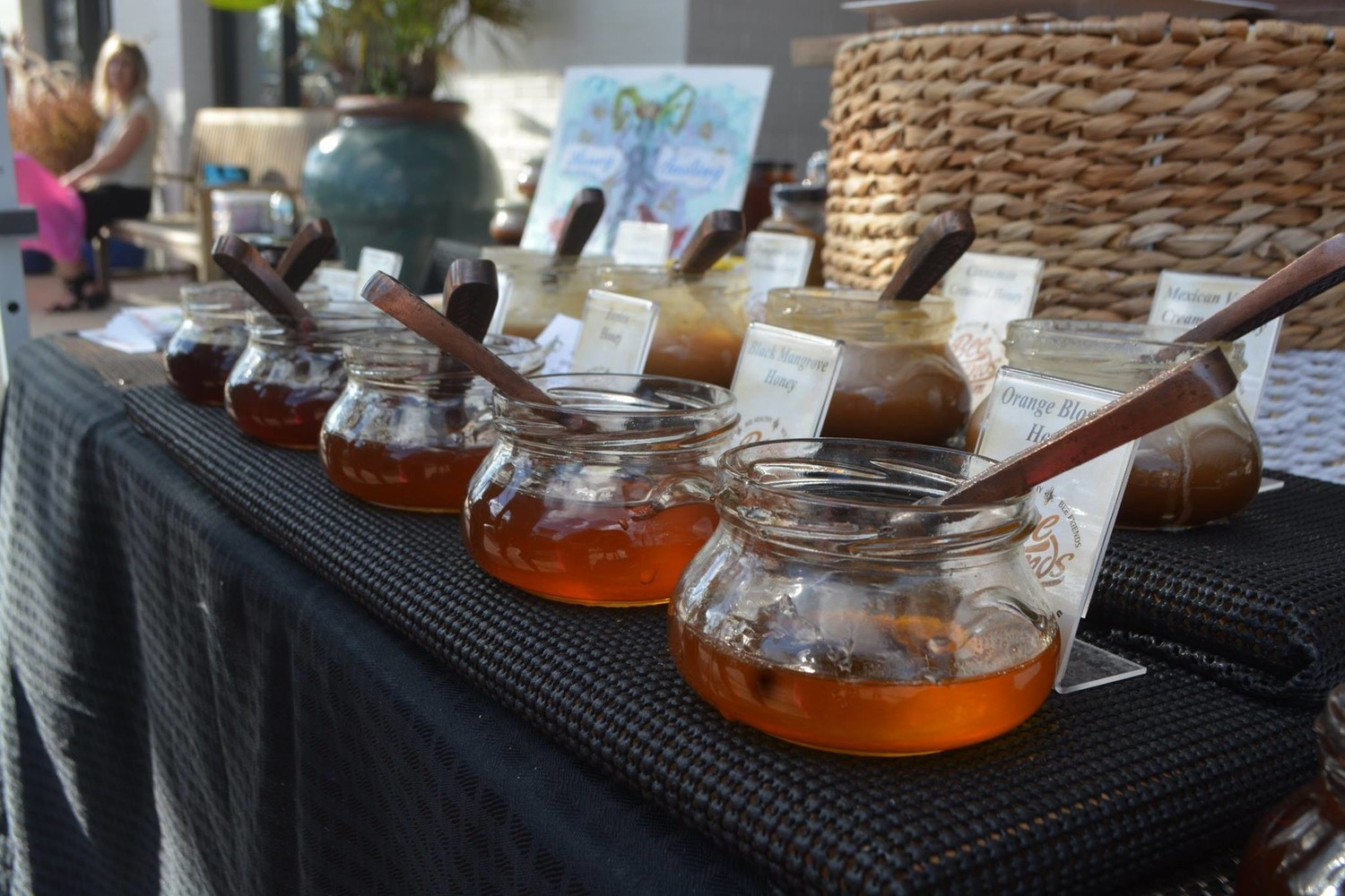 "A vendor displays different types of honey at the ""Oh What FUN!"" Christmas celebration."
