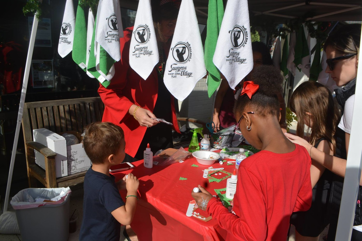 "Children enjoy an arts and crafts booth at the ""Oh What FUN!"" Christmas celebration."