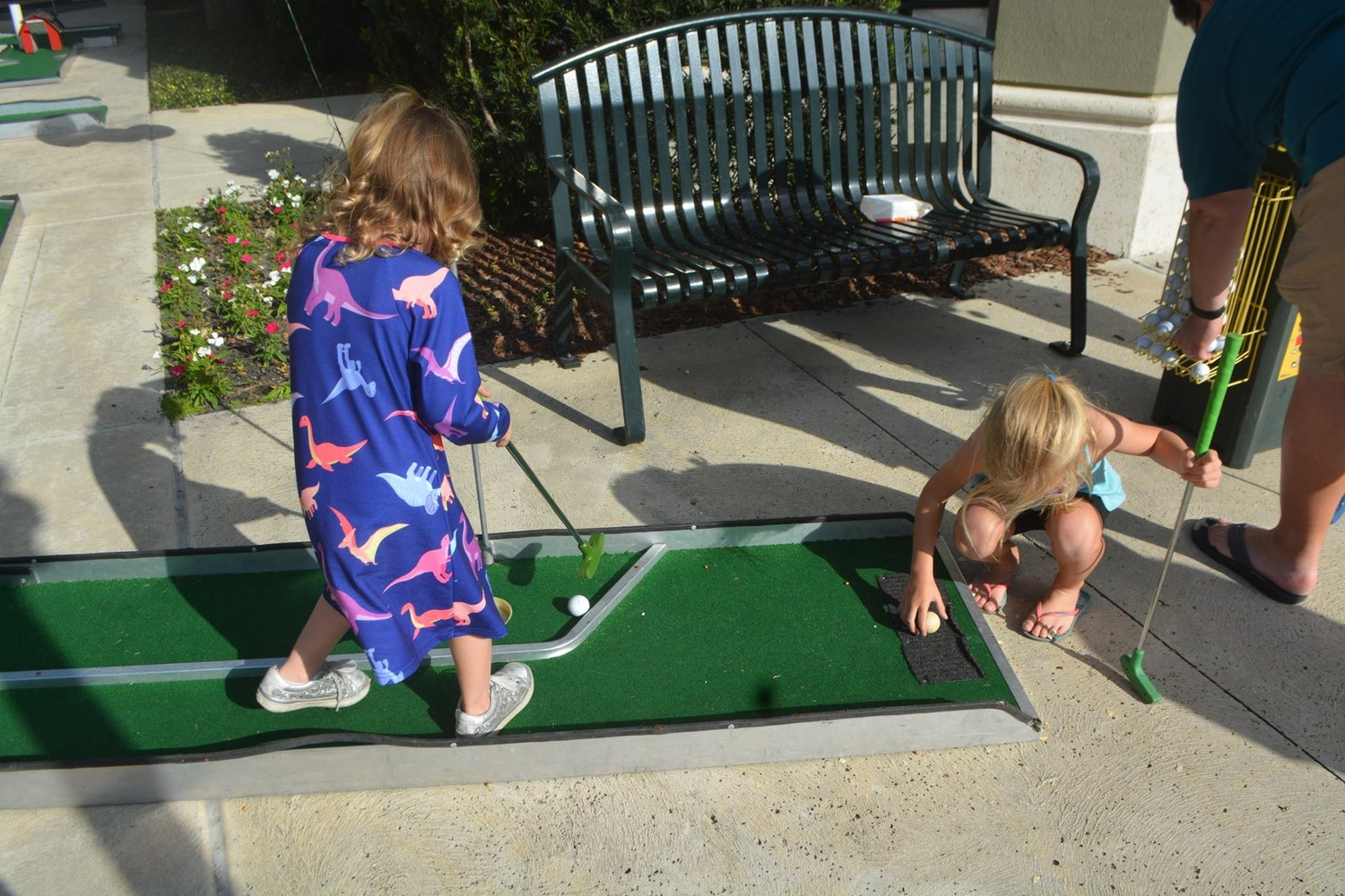 "Children play mini golf at the ""Oh What FUN!"" Christmas celebration."