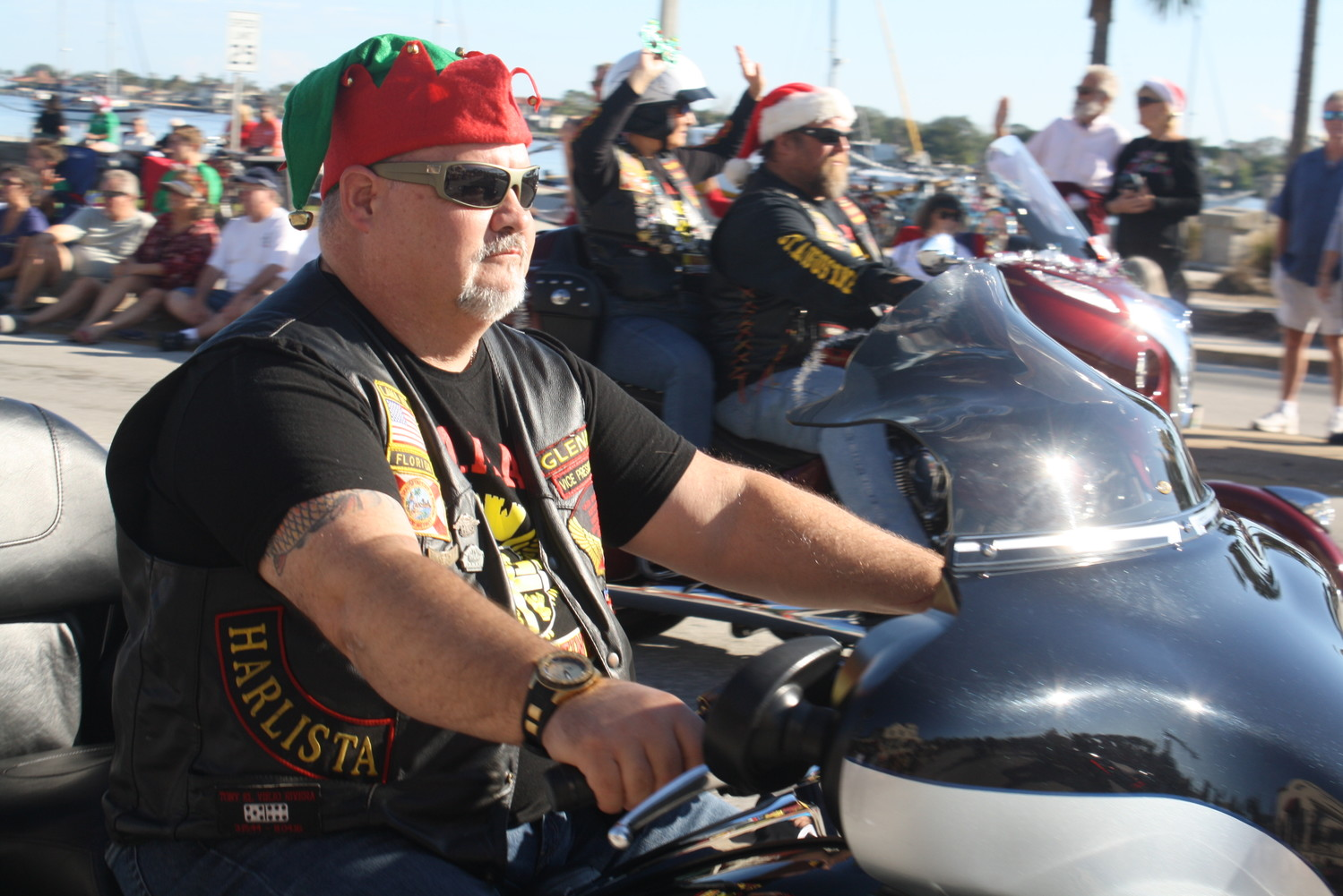 A motorcyclist takes part in the holiday cheer of the St. Augustine Christmas parade.
