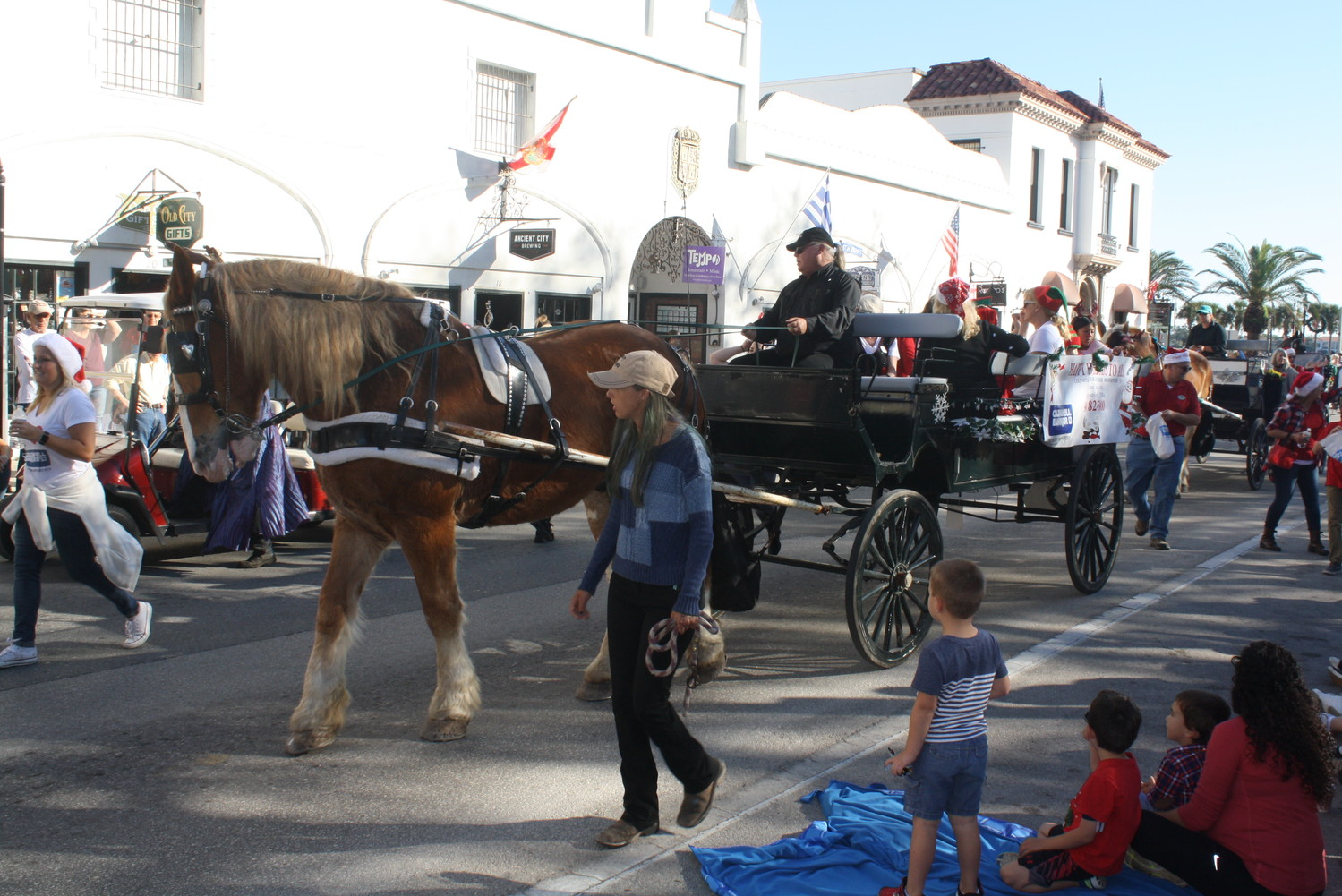 Coldwell Banker's horse drawn carriage rolls through the parade.