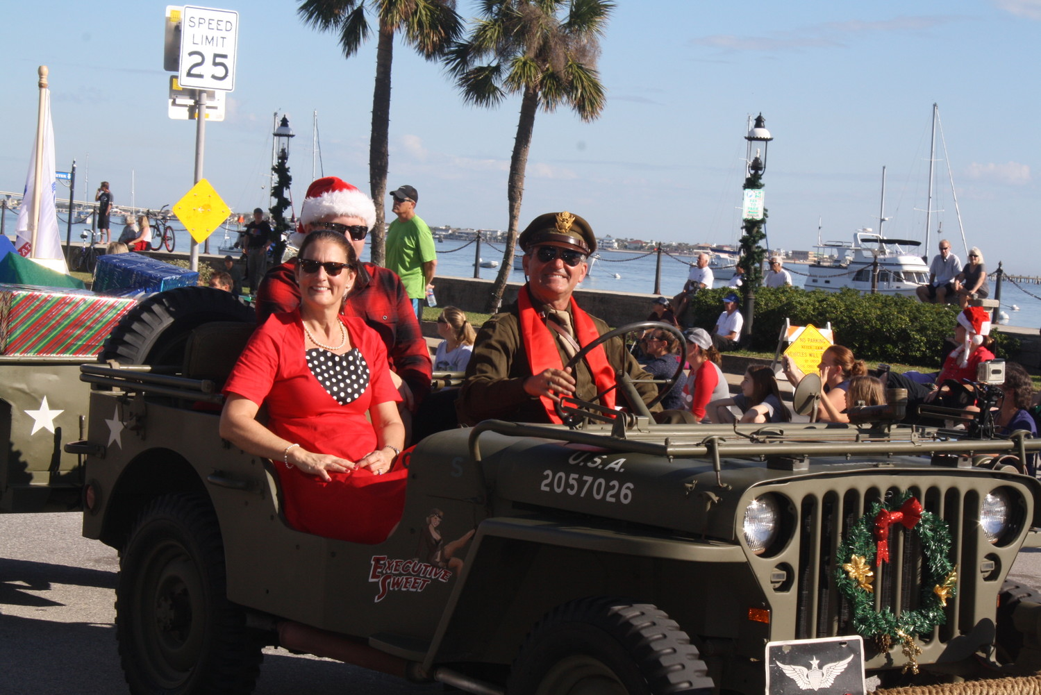 Historic military jeeps zoom down San Marco Avenue.