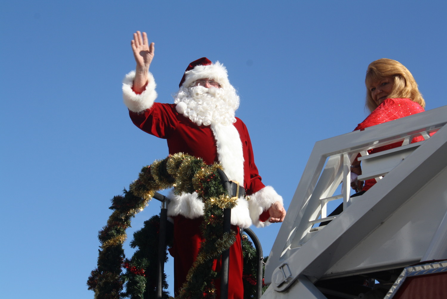 Santa Claus greets parade attendees as the last attraction of the annual holiday event.