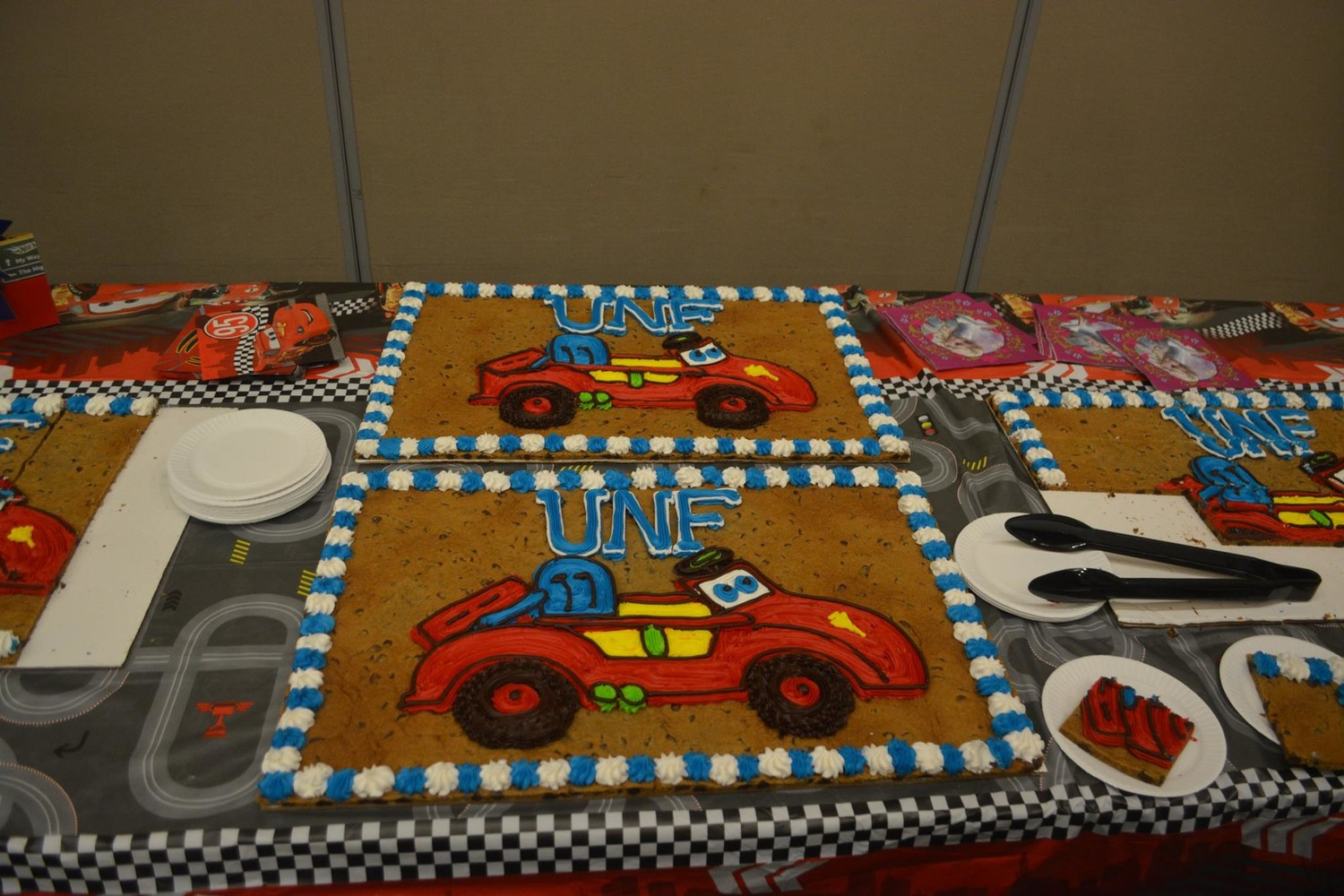 An Adoptive Toy Project-themed cake is displayed at the event.