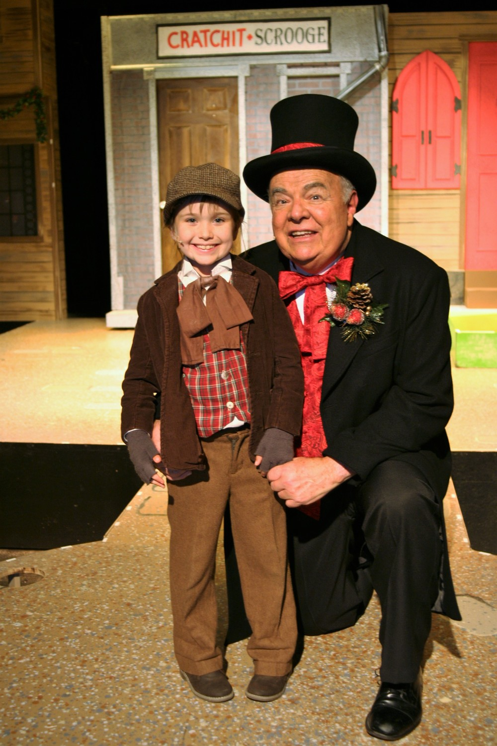 "In the Alhambra production of ""Christmas Carole,"" Ebenezer Scrooge is portrayed by director Tod Booth (right), and Lucy Feagins is Tiny Tim."