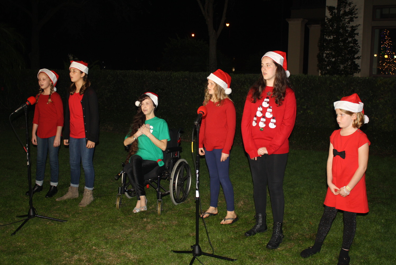 A group of girls sings for guests at Nocatee-A-Glow.