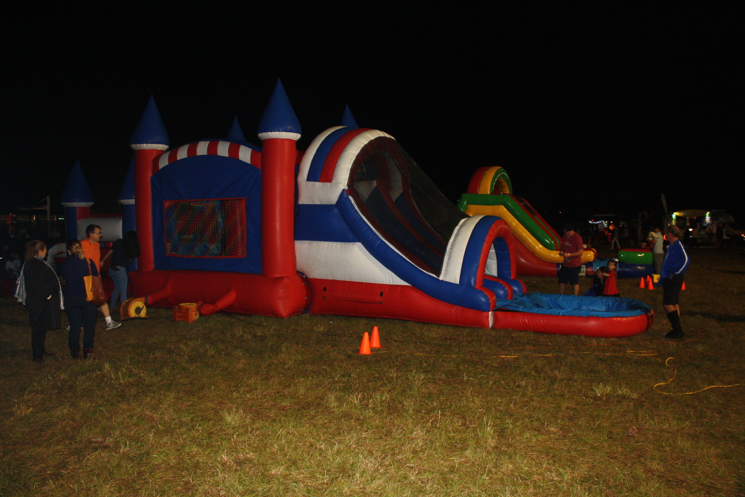 Guests enjoy playing in a bounce house.