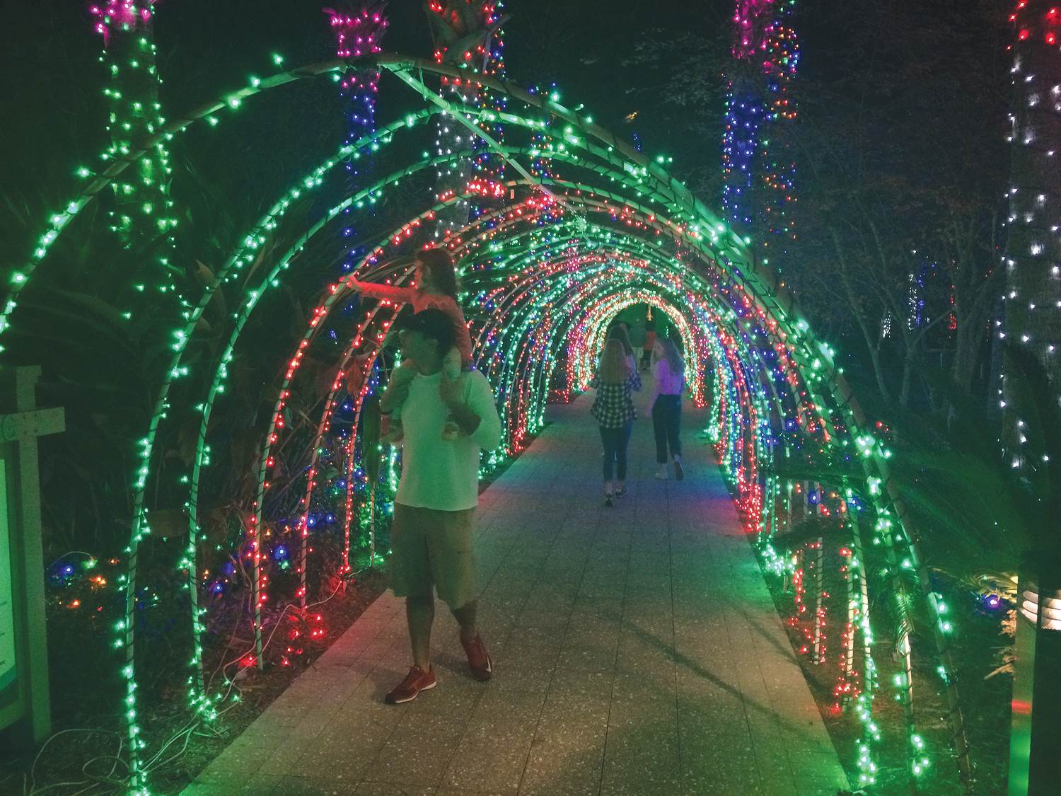 Christmas lights and decorations are displayed throughout Nocatee-A-Glow