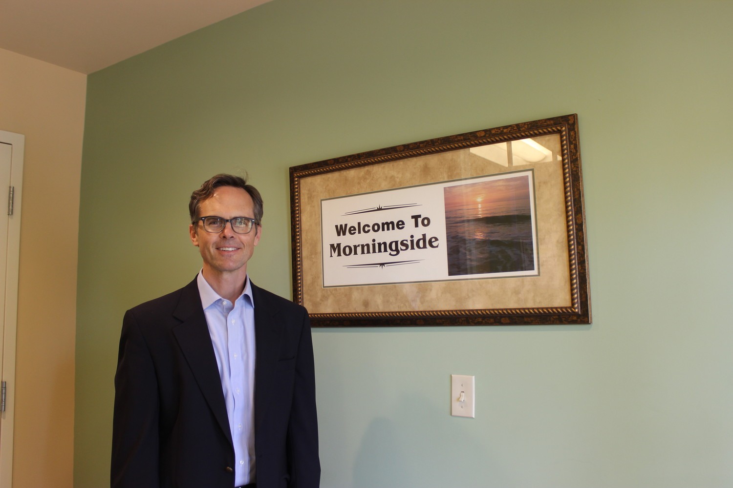 Dr. Todd Snowden stands beside a Morningside photo.