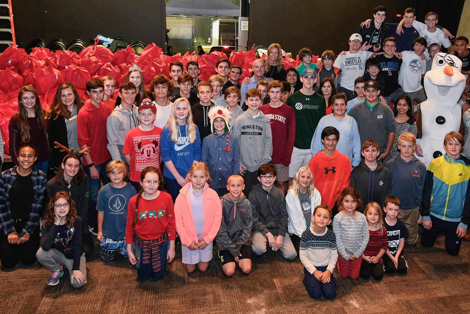 "Volunteers join Jim and Tabitha Furyk following their foundation's ""Hope for the Holidays"" event on Dec. 7 at Ponte Vedra Concert Hall, which resulted in the packing of 3,500 bags of food for local children in need."